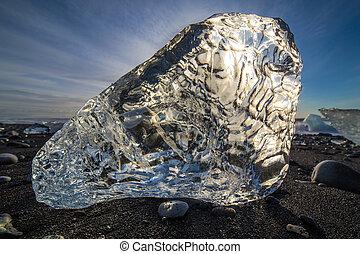 Refraction - Ice block from Jokulsarlon melting slowly on ...