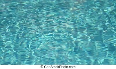 Refraction of sunlight in swimming pool water. Tripod.