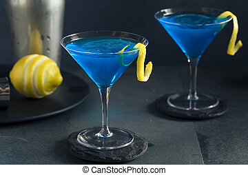 Refreshing Blue Martini Cocktail with Lemon Garnish