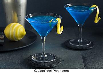 Refreshing Blue Martini Cocktail with Lemon Garnish