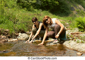 refreshing clean water - Two girls refreshing with clean...