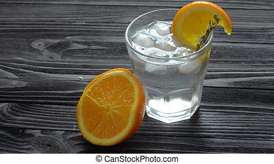 Refreshing cocktail on a wooden table