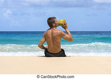 Refreshing coconut water by the sea - Tan shirtless ...