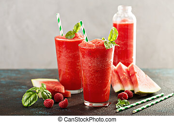 Refreshing cold summer drink watermelon slushie with basil