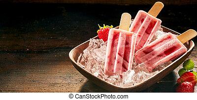 Refreshing frozen fresh strawberry popsicles