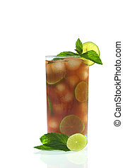 Refreshing iced tea out of black tea, ice cubes, lime slices, garnished with fresh mint leaves and lime slices