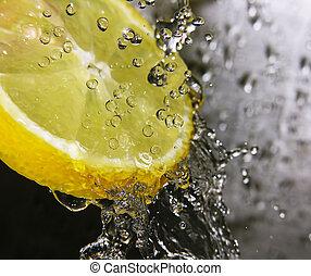 Refreshing lemon - Water drops falling onto a lemon - focus ...