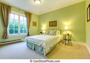 Cozy bedroom with mint wall and beige floor. Refreshing white and aqua bedding