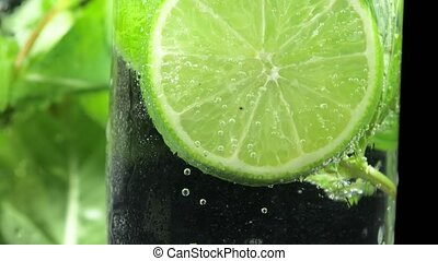 Refreshing Mojito cocktail as background.