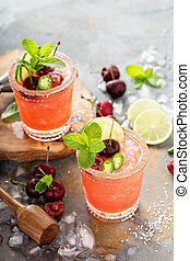 Refreshing summer cocktail with sweet cherry and ice