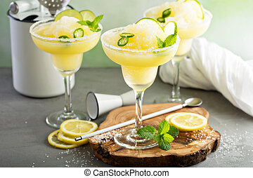 Refreshing summer margarita cocktail with fruits and hot ...