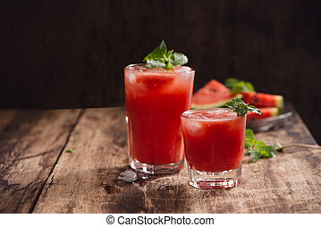 Refreshing summer watermelon in glasses with slices of watermelon