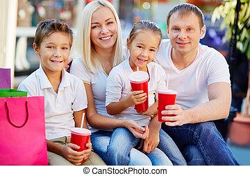 Refreshment - Portrait of joyful family having break and ...