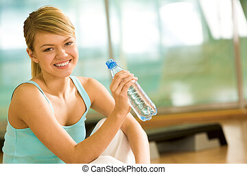 Refreshment - Portrait of lovely girl holding bottle of...