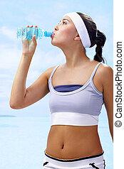 Refreshment - Portrait of lovely girl holding bottle of...