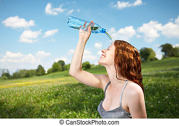 Refreshment - The girl in park pours over a face cold water