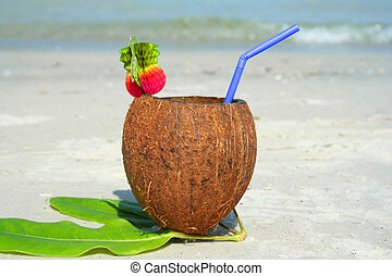 Tropical drink at the beach in summer time