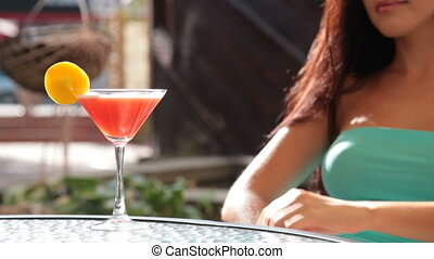 Refreshment - unrecognizable woman drinking cocktail in...
