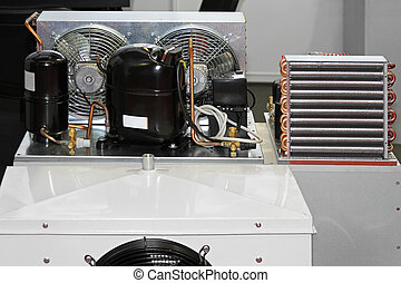 Refrigeration compressor unit with heat excanger and condenser