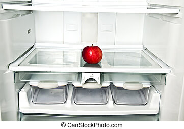 Refrigerator close up with red apple