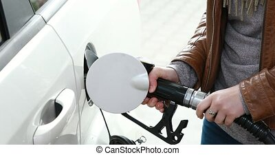 Refuel the car - on gas station - Close view of women hand...