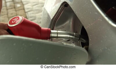 Refueling the car at petrol station - Close-up shot of a man...