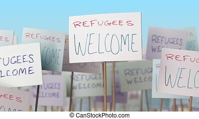 REFUGEES WELCOME placards at street demonstration....