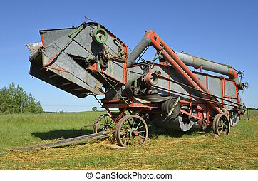 Refurbished old threshing machine - An old threshing machine...