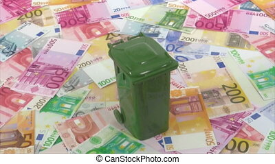 Garbage container rotating on euro banknotes