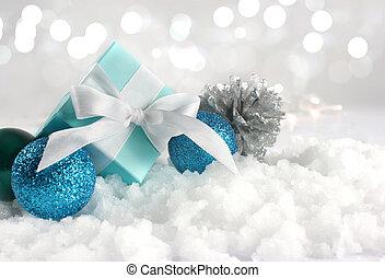 regalo de navidad, y, decoraciones, anidado, en, nieve