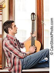 regarder, sien, rebord fenêtre, séance, jeune, main, guitare, tenue, acoustique, homme, inspiration., beau
