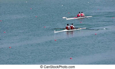 Regatta in rowing on the tranquil lake, full hd video