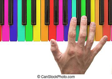regenboog, pianotoetsenbord, met, hand