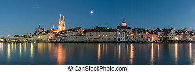 Regensburg in the evening with view to the Cathedral and stone bridge, Germany