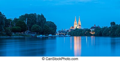 Regensburg with the yacht harbor at the danube river and view to saint peter cathedral at blue hour