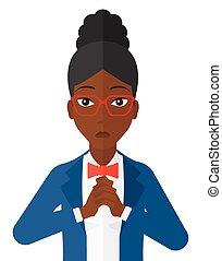 Regretful woman with clasped hands. - Regretful an african-...
