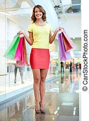 Regular customer - Vertical portrait of a female shopper ...