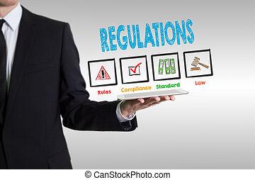 Regulations concept. Man holding a tablet computer