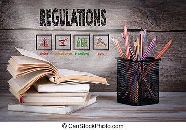 regulations., stakk af bøger, og, blyanter, på, den, af træ, tabel.