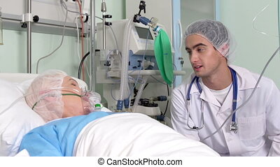 Positive specialist talking to a recovering patient of senior age