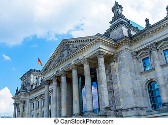 Reichstag Building and German Flag, Berlin - The Reichstag...
