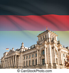 Reichstag (Bundestag) building in Berlin with flag on background - Germany