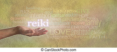 Female hand, open with the word 'REIKI' floating above, surrounded by a healing relevant word cloud on a light gold stone effect background wide banner