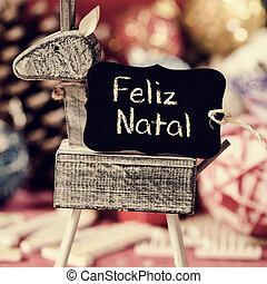 reindeer and text feliz natal, merry christmas in portuguese
