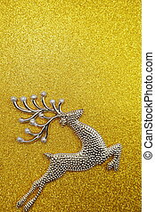 Reindeer Christmas decoration on gold glitter background