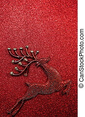 Reindeer Christmas decoration on red glitter background