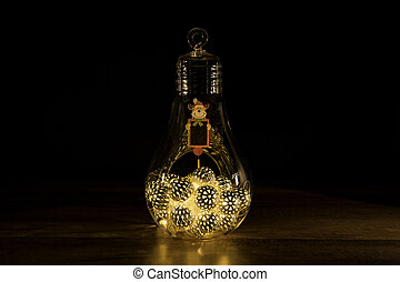 Reindeer sign with Christmas lights in glass light bulb