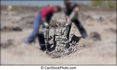 Reinforced concrete pillar picking - Construction workers...