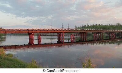 Reinforced concrete road bridge in Siberian taiga