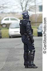 reino unido, oficial de policía, en, alboroto, engranaje